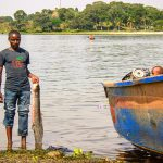 Kato, a fisherman from Kalangala Island, shows his catch. Lake Victoria is one of the most diverse fresh waters with more than 500 species of fish.