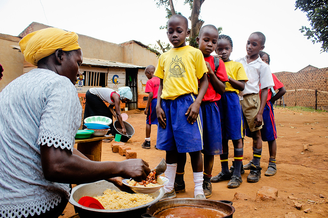 School children line up for lunch at the Trust Future primary school in the Wakiso district.